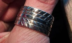 Hand made solid silver Tyre (tire) ring just polished and ready to adorn someone's hand! Hand made by Karen Ryder. Yokohama S Drive tyre tread design. Tire Ring, Tyre Tread, Silver Ring Designs, Yokohama, Sterling Silver Rings, Jewellery, Bracelets, Leather, Handmade