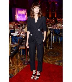 @Alexandra M What Wear - Alexa Chung                 To present Christopher Kane with his Fashion Star award during the 30th Annual Night of Stars event last month, Chung donned a jewel-accented, cropped suit from his S/S 14 collection. By scrunching the sleeves, wearing hefty sandals, and keeping her signature hair and makeup unchanged, Chung wears the look with the same ease as a pair of denim cutoffs.