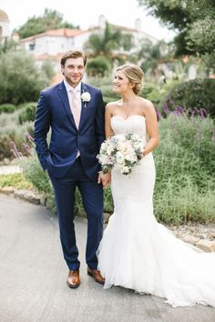A french blue suit and pink tie with a gorgeous bride by his side! View the whole wedding here: http://thedailywedding.com/2015/11/15/lush-ojai-wedding-danielle-bobby/