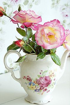 Roses in pretty pitcher