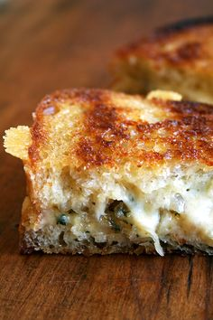 THE BEST GRILLED CHEESE sandwich with gruyere , Caramelized shallots and thyme. The bread is first browned in a buttered skillet. The toppings are added and melted in the oven. Then the whole thing folds together in one heavenly gooey, buttery, cheesy goodness!