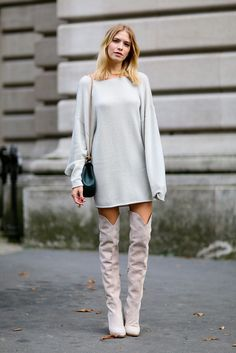 Lena Perminova in a gray sweater mini dress paired with tall blush suede boots