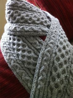 Free Knitting Pattern for Lupin Scarf - Dale Hwang was inspired by a scarf worn by Remus Lupin in the movie Harry Potter and the Prisoner of Azkaban to create this cable scarf. Pictured project by pixisticks