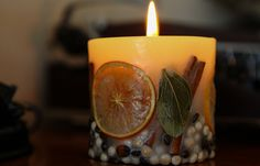 Candlelight with orange, pot pouri and cinnamon