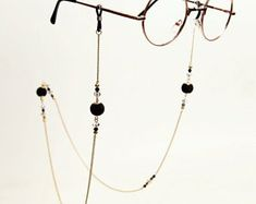 Check out our glasses chains selection for the very best in unique or custom, handmade pieces from our shops. Cute Glasses, Chains, Eyewear, Fashion Jewelry, Sunglasses, Etsy, Wire, Lenses, Clothing