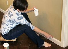 The Lazy Girl's Secret to Caulking Baseboards--use a rolling plant stand to sit on