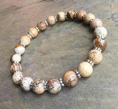 Bracelet composé de jaspe naturel de haute qualité ronde diamètre 8 mm avec véritable argent 925 de Bali, Indonésie. S'il vous plaît mesurer votre tour de poignet exact avec ruban à mesurer et choisir cette taille dans le menu déroulant d'option. Lorsque vous effectuez votre bracelet,