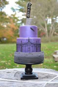 Purple, gray and black Halloween cake with gum paste knife.  ~ all edible and hand piped