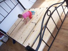 How to make your own boxspring! Make sure you cover your new slats with thick smooth fabric (stapled to the slats) to protect your mattress!