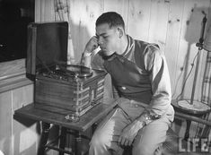 Joe Louis Listening to Music