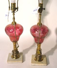 Pair of cranberry glass font table lamps
