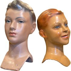 vintage-boy-fashion-busts-in-papier-maché Two Vintage Mannequin Heads of boys constructed in Papier-Maché. Both are in original paint and have crystals set into the eyes. Made to fit on mannequin bodies, one bust is signed on the back E.Girard, which was a Paris Studio making busts for the famous nearby company of Siegel & Stockman. (The other bust is unsigned but is similar enough to identify with the same maker) Circa 1935-1960 from Paris France. In good condition with a few minor…