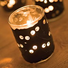Cool Halloween craft project: Hole punch creepy eyes in black paper and wrap a votive.