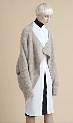 The must-have cozy, oversize cardigan you will want to live in -- made from a sumptuous and sensual Peruvian superfine alpaca, envelopes the figure in a generous neutral-tone cardigan detailed with extended ribbed sleeves. Wear it right-side-up to take full advantage of its cozy-up cocoon shape or flip it around to create a dramatic shawl-collar drape and clean-line hem.