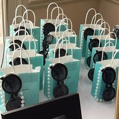 These small bags make the perfect tiffany theme party favors. Measuring about 4x5inches. Set of 10 Please leave what you'd like the bags to say in the notes as well as the event date