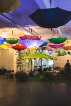 Colourful umbrellas decorating wedding reception venue | Photography by http://s6photography.co.uk/
