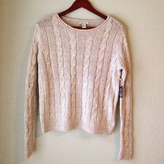 """Oatmeal Cable Knit Sweater Cozy and cute cable knit sweater. Neutral color and classic style make this a wardrobe staple! Rolled hem detail at neckline. Tag says pink & gray, I think it's more of a beige/oatmeal color. Color truest in pic 2. Super soft and cozy! Never worn. 66% cotton, 23% acrylic, 11% polyester.   Measurements: 22"""" long and 18"""" armpit to armpit.  Condition: Brand new, never worn.  Trades  Please ask any questions prior to purchasing. All sales final. Forever 21 Sweaters…"""
