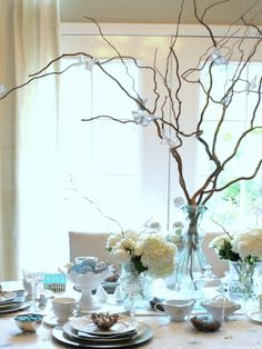 "This whimsical centerpiece is perfect for spring-inspired dinner parties and is surprisingly simple to create. ""I gathered several manzanita branches into a tall vase to bring the outdoors in. These gorgeous branches, with their twists and curls, make such a dramatic statement on a tabletop,"" Katie Riley of Centsational Girl says. You can even replace the butterflies with seasonal objects, like leaves or snowflakes, for a gorgeous centerpiece to celebrate any holiday or season."