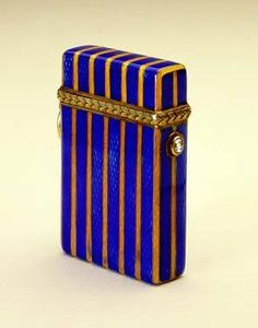 Fabergé cigarette lighter with the Rothschild family racing stripes, gold with blue and yellow enamel and diamond pushpiece, workmaster Henrik Wigström, 1911 Cool Lighters, Art Deco Vanity, Vintage Cigarette Case, Cigar Cases, Art Deco Movement, Vintage Ashtray, Smoking Accessories, Statue, Vintage Antiques