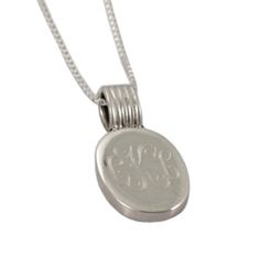 Monogrammed oval sterling silver pendant on silver chain