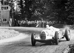 1937. Bernd Rosemeyer in wild action with the Auto Union Type C-1937. III Donington Gp. Donington Park