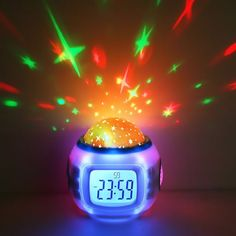 Turns your kids' room into a twinkling starry night sky. This egg shaped projection alarm clock has time/date and temperature display features along with four natural sound songs and six chord songs for you to choose from.
