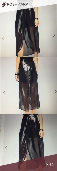 NWOT BCBG silver metallic sheer maxi skirt 4 Great condition. Never worn. New without tags.  I posted some professional photos from the website, as well as the actual skirt. Skirt is silver metallic.  Any questions just ask :) BCBGeneration Skirts Maxi