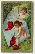 Cherubs with an envelope full of Valentine's Day hearts vintage Valentine card
