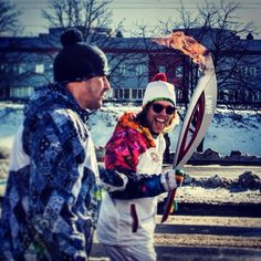 Adventurer of the Year honoree and snowboarder Kevin Pearce carries the Sochi Olympic torch adorned with a Love Your Brain sticker; Photograph @KevinPearce on Instagram
