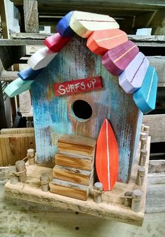 A shop nearby a beach can decorate it in several unique ways. The first idea could be achieved making use of pallet wood to make a miniature beach house and color it with attractive colors.