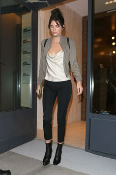 Kendall Jenner steps out in a bomber jacket, silk top, black pants and booties. See all the model's best outfits here: