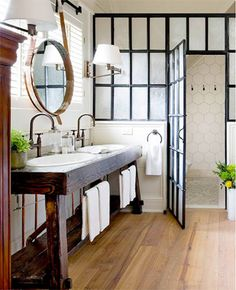 Like the shower partition but squeegeeing it from the inside would be a pain if they are individual panes of glass...solved if the iron framework is only on the outside.