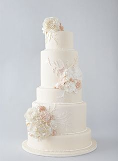 Gorgeous Cake | wedding cake...love the flowers colors and where they go on the cake