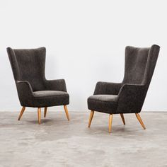 Having launched his successful career in the 1920s, German designer Max Ernst Jahn designed this attractive pair of chairs in 1956, but has now fallen into obscurity. As one of the main figures promoting Art Deco lines in Leipzig, he created this design for the small but enduring manufacturing company Hellerauer Werkstätten during the latter part of his career.