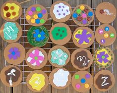 Cardboard Cookies for Dramatic Play Center. Decorate the cardboard circles with various craft supplies. Kids enjoy making them and opening up a cookie shop to sell them. So easy and fun.