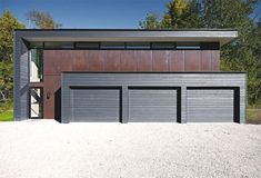 I would say i like more traditional, antiquated housing better, but thus Minimalist house with three car garage is really well designed and pleasing to look at.