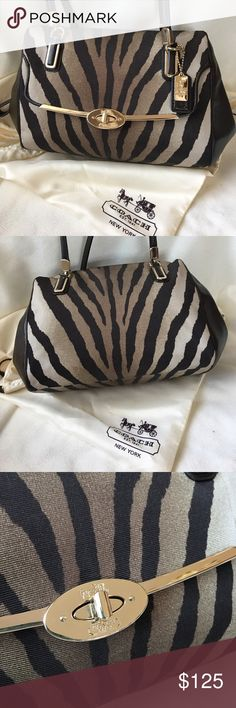 """Coach Zebra Madeline Purse Zebra print on elegant faille fabric, compact satchel with graphic color and pattern. Spacious inside, trimmed in hand-worked leather and finished with Madison hardware. Approx. 13 3/4"""" x 7 1/2"""" x 4 3/4"""" and 7 1/2"""" handle drop. Zip top closure. Exterior front pocket with turnlock flap closure. Interior zip and multifunction pockets. Coach Bags Satchels"""