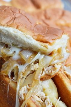 These Cheesy French Onion Chicken Sandwiches are the ultimate party or game day food! Soft rolls loaded up with slow cooker chicken, caramelized onions and loads of melt cheese. This is the perfect recipe to feed your hungry crowd! #ad #RealCheesePeople