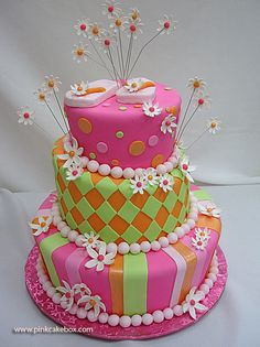 3 tier pink cake with flowers and flip flops on top, so cute!