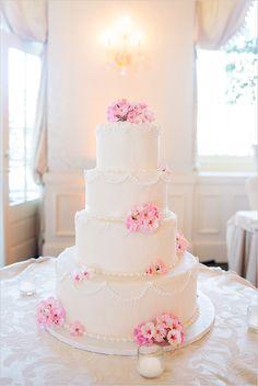 white tiered wedding cake captured by Michelle Girard Ghotography #weddingcake #weddingphotographer #weddingchicks http://www.weddingchicks.com/2014/02/25/michelle-girard-photography-and-design/