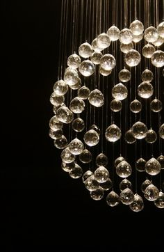 Non traditional chandelier with crystal globes hanging down to catch the light & Sculptural Chandeliers Accented With Real Dandelion Seeds ...