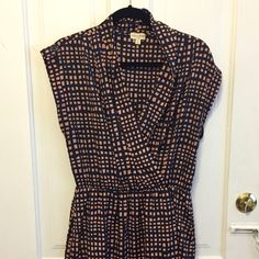 Cute Checked Mini Dress Very cute, barely worn mini dress. Has an elastic waist that shows off your shape and is pretty short. Cute button detail on the sleeve too. Maison Jules Dresses Mini