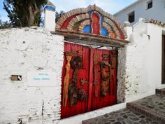 A sculptor's door in the village of Macharaviaya, Spain. Lots of history in such a tiny place.