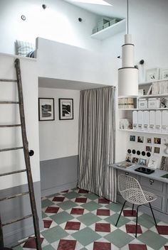 1 of 2 sleeping areas (& storage) created in a tiny attic by utilizing the ceiling height of the old buildings space... 'Tiny attic apartment in Paris by Marianne Evennou'...
