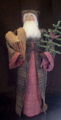 Handmade primitive santa doll in plaid coat with a heart and christmas tree