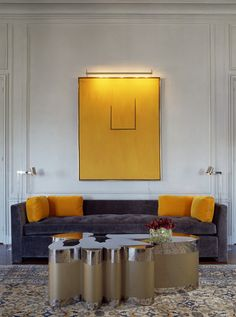 Living Room - Metallic table with vibrant citrus yellow speaks how important colour, shape, form and structure impacts our space. Distinctive & elegant. (re-pinned photo only from David Duncan Livingston)