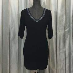 Guess Open Back Dress Material is light and and hangs well. Beading around neck and back is gorgeous and gives the dress a little glamour. Dress is super chic and great for a night out with the girls! One bead is missing in the back (as shown in picture) but it's barely noticeable. Guess Dresses Backless