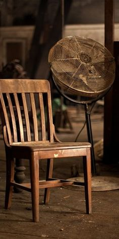 brown chair and a fan