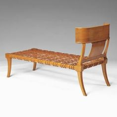 This is a replica of a common Kline, a piece of furniture which was used as a sofa or bed in Ancient Greece. What is interesting to me, is that this particular Kline shares the same legs as the Klismos chair.