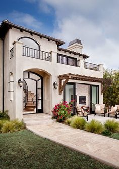 Spanish stucco house exterior mediterranean with outdoor dining wrought iron stone fireplace